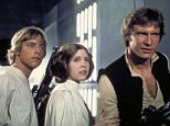 """Actors, from left, Mark Hamill as Luke Skywalker, Carrie Fisher as Princess Leia and Harrison Ford as Han Solo, appear in a scene from Lucasfilm's """"Star Wars: Episode IV, A New Hope,"""" in this undated promotional photo. Lucasfilm Ltd. and 20th Century Fox announced Tuesday, Feb. 10, 2004, that the original three """"Star Wars"""" films will be released on DVD on Sept. 21, 2004, in North America. (AP Photo/Lucasfilm, Ltd. & TM)"""