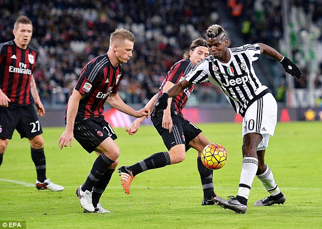Juventus midfielder Paul Pogba (right) finds himself outnumbered by Milan players during the match