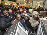 Mandatory Credit: Photo by Ray Tang/REX Shutterstock (4272156ae)..Customers fighting over discounted large television sets..Black Friday sales at Asda Wembley Superstore, London, Britain - 28 Nov 2014..
