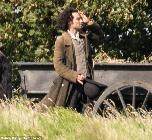 He's back! Although there was no sign of the hunky Irish actor, 32, stripping off his topcoat, hat and shirt, he cut quite the dapper gentleman in his period costume