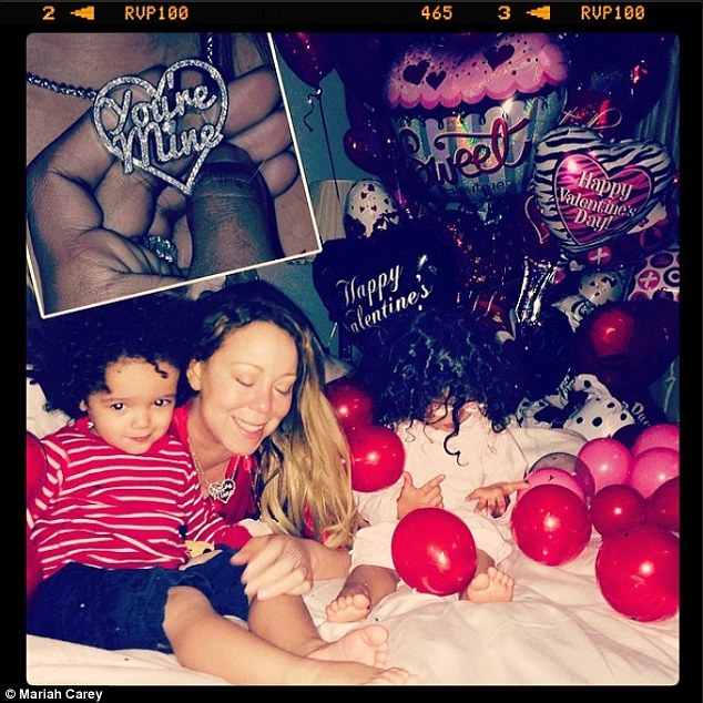 Nicely timed: Mariah showed off her new 'You're Mine' necklace which also happens to be the title of her new single