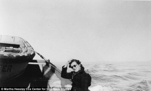 Carol Steinbeck  sitting on rail of Western Flyer.The Western Flyer was launched as a purse seiner by Western Boat Building Company of Tacoma in 1937. Descendants of the shipyard's founder have long wanted to see this boat find a credible savior