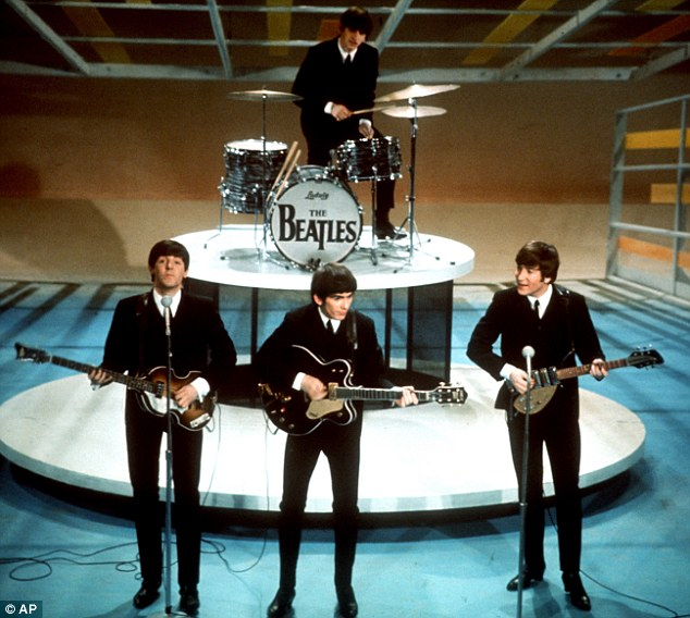 Divide: Teens in the 1960s divided themselves based on whether they were a fan of The Beatles (pictured in the 1960s) or the Rolling Stones