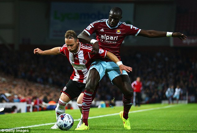 QPR bound? Song's arrival at Upton Park could see Mohamed Diame joining Harry Redknapp at QPR