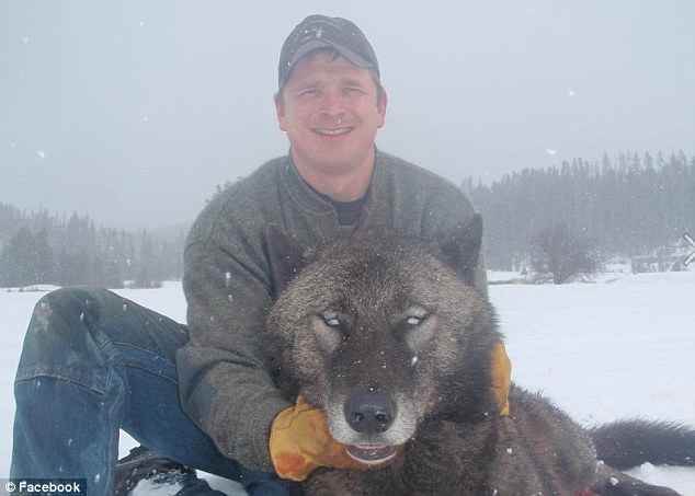 Trapped: A hunter poses with his kill in another photo inciting heated debate