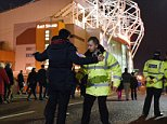 Football fans are searched as they arrive outside Old Trafford Stadium in Manchester, north west England, on November 25, 2015, ahead of the UEFA Champions League Group B football match between Manchester United and PSV Eindhoven. AFP PHOTO / OLI SCARFFOLI SCARFF/AFP/Getty Images