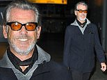 23.NOVEMBER.2015 - LONDON - UK\n*** EXCLUSIVE PICTURES ***\nFORMER JAMES BOND ACTOR PIERCE BROSNAN ARRIVES AT HEATHROW AIRPORT IN WEST LONDON COMING FROM LOS ANGELES. PIERCE WAS DRESSED CASUAL SPORTING A GREY  BEARD AS HE STROLLED THROUGH THE AIRPORT.\nBYLINE MUST READ : XPOSUREPHOTOS.COM\n***UK CLIENTS - PICTURES CONTAINING CHILDREN PLEASE PIXELATE FACE PRIOR TO PUBLICATION***\nUK CLIENTS MUST CALL PRIOR TO TV OR ONLINE USAGE PLEASE TELEPHONE 0208 344 2007
