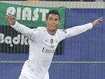 Real Madrid's Cristiano Ronaldo celebrates his opening goal while Shakhtar's goalkeeper Andriy Pyatov looks on during the Champions League Group A soccer match between FC Shakhtar and Real Madrid at Arena Lviv stadium in Lviv, Western Ukraine, Wednesday, Nov. 25, 2015. (AP Photo/Efrem Lukatsky)