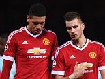 MANCHESTER, ENGLAND - NOVEMBER 25:  Chris Smalling (12) and Morgan Schneiderlin of Manchester United (28) in discussion after the UEFA Champions League Group B match between Manchester United FC and PSV Eindhoven at Old Trafford on November 25, 2015 in Manchester, United Kingdom.  (Photo by Michael Regan/Getty Images)