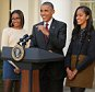 WASHINGTON, DC - NOVEMBER 25:  U.S. President Barack Obama delivers remarks with his daughters Sasha (L) and Malia during the annual turkey pardoning ceremony in the Rose Garden at the White House  November 25, 2015 in Washington, DC. In a tradition dating back to 1947, the president pardons a turkey, sparing the tom -- and his alternate -- from becoming a Thanksgiving Day feast. This year, Americans were asked to choose which of two turkeys would be pardoned and to cast their votes on Twitter.  (Photo by Chip Somodevilla/Getty Images)
