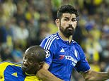 Maccabi Tel Aviv's Israeli defender Eliazer Dasa (L) controls the ball as Chelsea's Spanish forward Diego Costa defends during the UEFA Champions League, group G, football match between Maccabi Tel Aviv and Chelsea FC at the Sammy Ofer Stadium, in the Israeli coastal city of Haifa, on November 24, 2015. AFP PHOTO / JACK GUEZJACK GUEZ/AFP/Getty Images