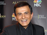 FILE - In this Oct. 27, 2003, file photo, Casey Kasem poses for photographers after receiving the Radio Icon award during The 2003 Radio Music Awards at the Aladdin Resort and Casino in Las Vegas. Three of Kasem's children sued their father's widow, Jean Kasem, on Wednesday, Nov. 25, 2015, for wrongful death, elder abuse and intentional infliction of emotional distress, claiming her actions shortened the popular radio personality's life. (AP Photo/Eric Jamison, File)