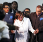 Irma Burns, center, mother of Jamar Clark, is escorted from her son's casket during funeral services at Shiloh Temple International Ministries Wednesday, Nov. 25, 2015 in Minneapolis. A steady stream of mourners entered the north Minneapolis church on Wednesday to pay their respects to Clark, whose death in a confrontation with police sparked more than a week of protests. (Jerry Holt/Star Tribune via AP)  MANDATORY CREDIT; ST. PAUL PIONEER PRESS OUT; MAGS OUT; TWIN CITIES LOCAL TELEVISION OUT