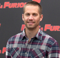 """FILE - In this April 29, 2011, file photo, actor Paul Walker poses during the photo call of the movie """"Fast and Furious 5,"""" in Rome. Walker's father sued Porsche on Wednesday, Nov. 25, 2015, for wrongful death,  claiming the Porsche sports car he was riding in was defective and lacked safety features that might have saved his life during a 2013 crash in Valencia, Calif.  (AP Photo/Andrew Medichini, File)"""