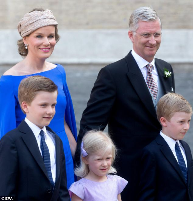 Although he attended the wedding, pictured here with his wife Mathilde and their children, King Philippe had not expressly given his permission for the union