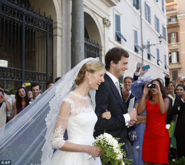 Lili, who arrived at the ceremony with her father Ettore Rosboch von Wolkenstein, wore a sweeping white wedding gown complete with veil and tiara and natural, dewy make-up for the ceremony