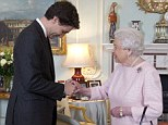 Queen Elizabeth II welcomed the Canadian prime minister to Buckingham Palace during a private audience but eyes were drawn to the Queen's electric fire that was warming the room behind her