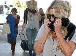 Kim Zolciak's daughter Brielle covers her lips after getting lip fillers from Kylie Jenners plastic surgeon!Seen at Lax airport!\n\nPictured: Brielle Zolciak-Biermann\nRef: SPL1185302  251115  \nPicture by: Atlantic Images  / Splash News\n\nSplash News and Pictures\nLos Angeles: 310-821-2666\nNew York: 212-619-2666\nLondon: 870-934-2666\nphotodesk@splashnews.com\n