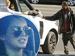 Please contact X17 before any use of these exclusive photos - x17@x17agency.com   Kendall Jenner and friends are feeling the holiday spirit. They drove around on Thanksgiving in her custom Range Rover and gave food to homeless people from inside the car.  November 26, 2015 X17online.com PREMIUM EXCLUSIVE