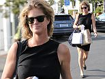 NON EXCLUSIVE PICTURE: MATRIXPICTURES.CO.UK PLEASE CREDIT ALL USES UK RIGHTS ONLY New Zealand born supermodel, actress and television personality Rachel Hunter is pictured during a shopping spree at Fred Segal in West Hollywood, California. The 46-year-old, who has her hair tied up messily, looks chic wearing a simple black dress paired with grey pumps. NOVEMBER 24th 2015 REF: MXP 153509 WCN/ROSARIO