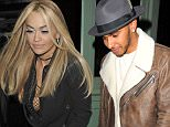 24.NOVEMBER.2015 - LONDON - UK SINGER RITA ORA AND F1 RACING DRIVER LEWIS HAMILTON SEEN LEAVING SEXY FISH RESTRAUNT IN LONDON AFTER CELEBRATING HER 25TH BIRTHDAY. LEWIS WORE RIPPED DENIM JEANS, A BROWN LEATHER COAT, HAT AND BOOTS BYLINE MUST READ : EBELE / XPOSUREPHOTOS.COM ***UK CLIENTS - PICTURES CONTAINING CHILDREN PLEASE PIXELATE FACE PRIOR TO PUBLICATION *** **UK CLIENTS MUST CALL PRIOR TO TV OR ONLINE USAGE PLEASE TELEPHONE 44 208 344 2007**
