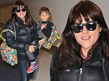 Selma Blair and son Arthur are all bundled up at LAX before taking a trip out of town for Thanksgiving weekend. Selma and Arthur also carried very colorful matching bags. November 25, 2015 X17online.com