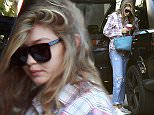 Beverly Hills, CA - Model, Gigi Hadid, looked worse for wear as she arrived back home from having a sleepover with new boyfriend, Zayn Malik.  The quick change artists soon left her worn out look at home and came out looking sporty chic to eat with her sister, Bella Hadid, and her dad, Mohamed Hadid at Il Pastaio restaurant.  AKM-GSI          November 25, 2015 To License These Photos, Please Contact : Steve Ginsburg (310) 505-8447 (323) 423-9397 steve@akmgsi.com sales@akmgsi.com or Maria Buda (917) 242-1505 mbuda@akmgsi.com ginsburgspalyinc@gmail.com