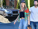 EXCLUSIVE: Adam Levine and his wife Behati Prinsloo look very happy as they head to a Rolls Royce dealership in Beverly Hills. The happy couple held hands as they walked around the dealership checking out different cars, eventually Behati was seen test driving a light blue two door Bentley.  Behati looked pretty happy after the test drive and the couple were seen heading indoors after and hung out for about an hour before leaving with the car. Bentley Continental.\n\nPictured: Adam Levine and Behati Prinsloo\nRef: SPL1184668  241115   EXCLUSIVE\nPicture by: Fern / Splash News\n\nSplash News and Pictures\nLos Angeles: 310-821-2666\nNew York: 212-619-2666\nLondon: 870-934-2666\nphotodesk@splashnews.com\n