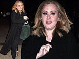 November 25,  2015: Adele wearing all black and a pair of animal print slip ons in New York City.\nMandatory Credit: Dara Kushner/INFphoto.com Ref.: infusny-05/42
