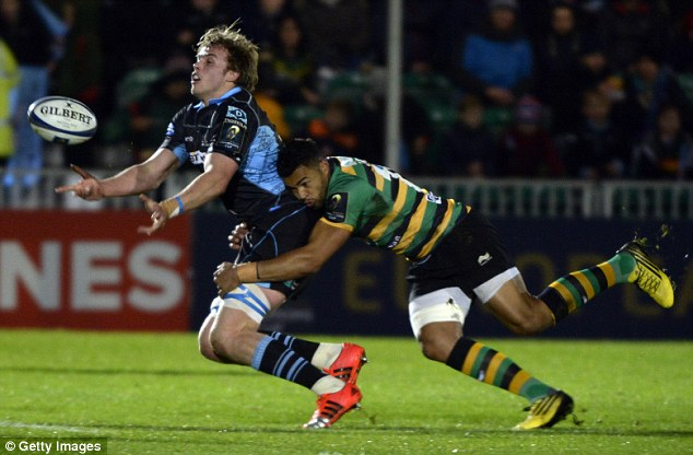 Glasgow lock Jonny Gray feels the full force of Northampton centre Luther Burrell's tackle at Scoutstoun