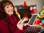 03 Oct 2014 --- Happy redhead shopping online with tablet --- Image by © Wavebreak Media LTD/Wavebreak Media Ltd./Corbis