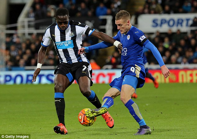 Jamie Vardy tucks the ball in between the legs of Moussa Sissoko on his way to firing Leicester ahead