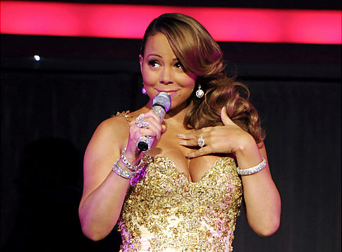 """Singer Mariah Carey drops out of """"For Colored Girls Who Have Considered Suicide When the Rainbow Is Enuf,' fueling rumors that she is pregnant. >"""
