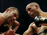 Lucian Bute (L) of Canada takes a punch from James DeGale of Britain during their International Boxing Federation (IBF) super middleweight title boxing match in Quebec City, Quebec November 28, 2015. REUTERS/Christinne Muschi