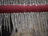 EDMOND, OK - NOVEMBER 28:   Ice hangs from a two inch guard rail on November 28, 2015 in Edmond, Oklahoma.    Heavy rain and ice conditions have left thousands without power and are being blamed for at least three deaths (Photo by J Pat Carter/Getty Images)