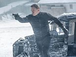Bond (Daniel Craig) leaping from the sliding damaged plane gun drawn in Metro-Goldwyn-Mayer Pictures/Columbia Pictures/EON Productions? action adventure SPECTRE. Obertilliach, Austria.