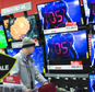 A holiday shopper browses the electronics section against a backdrop of televisions at a Target store, Friday, Nov. 27, 2015, in Newport, Ky.  (AP Photo/John Minchillo)
