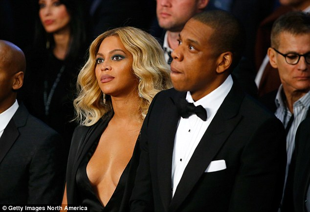 Beyonce and Jay Z watch the action from ringside at the Mandalay Bay Events Center in Las Vegas
