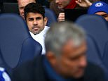 Diego Costa of Chelsea looks on from the substitutes bench behind manager Jose Mourinho during the Barclays Premier League match between Tottenham Hotspur and Chelsea played at White Hart Lane, London on November 29th 2015