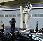 In this Sunday, April 19, 2015 photo, Mercedes driver Lewis Hamilton of Britain celebrates standing on his car after winning the Bahrain Formula One Grand Prix at the Formula One Bahrain International Circuit in Sakhir, Bahrain. (AP Photo/Luca Bruno)