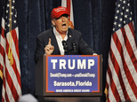 """Republican presidential candidate Donald Trump speaks to supporters at a campaign rally Saturday, Nov. 28, 2015 at Robarts Arena in Sarasota, Fla.  Trump bragged about his high standing in the polls, slammed super PACS as """"a scam"""" and dismissed nomination rivals Marco Rubio and Jeb Bush in a campaign stop Saturday in their home state of Florida.  (AP Photo/Steve Nesius)"""
