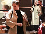 28 Nov 2015 - Los Angeles - USA *** STRICTLY AVAILABLE FOR UK AND GERMANY USE ONLY *** *** EXCLUSIVE ALL ROUND PICTURES *** Happy parents-to-be Anne Hathaway and Adam Shulman joined a few friends during dinner at Barrel and Ashes. Anne was all smiles, covering her growing bump with a trench coat. Speculation about The Intern actress' pregnancy gained steam when she sported a bump in Beverly Hills this week. According to E! News, Hathaway is in her second trimester. This will be the couple's first child. BYLINE MUST READ : XPOSUREPHOTOS.COM ***UK CLIENTS - PICTURES CONTAINING CHILDREN PLEASE PIXELATE FACE PRIOR TO PUBLICATION *** *UK CLIENTS MUST CALL PRIOR TO TV OR ONLINE USAGE PLEASE TELEPHONE 0208 344 2007*