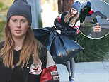 Picture Shows: Ireland Baldwin  November 27, 2015\n \n Actor Alec Baldwin's daughter Ireland Baldwin spotted doing some cleaning at her house in Santa Monica, California. Ireland jumped over the no sign with a no trespassing post in order to take out her garbage.\n \n Exclusive All Rounder\n UK RIGHTS ONLY\n FameFlynet UK © 2015\n Tel : +44 (0)20 3551 5049\n Email : info@fameflynet.uk.com