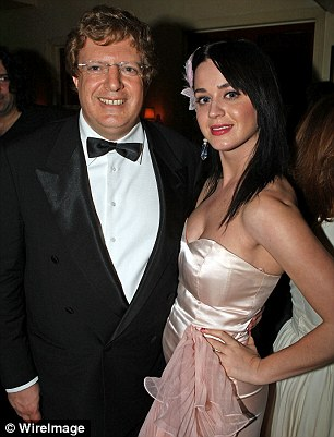 Odeon is part of a vast portfolio owned by the investment company ofmultimillionaire tax exile Guy Hands, pictured with singer Katy Perry in 2008