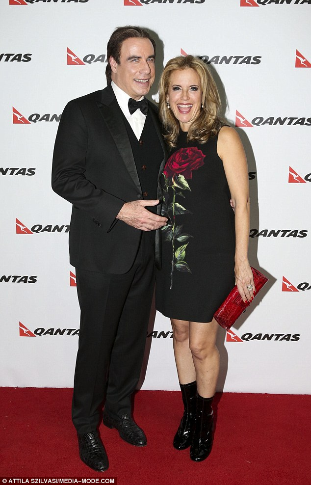 Well that's unusual! The sighting comes a day after John's appearance on the red carpet at a QANTAS airline event, at which he sported another unusual sartorial decision - a blonde streak in his dark hair