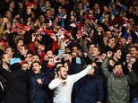 epa05041919 PSV Eindhoven fans celebrate after the UEFA Champions League group B soccer match between Manchester United and PSV Eindhoven at Old Trafford in Manchester, Britain, 25 November 2015. The match ended 0-0.  EPA/PETER POWELL