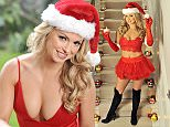 Ola Jordan makes for a sultry Santa as she decorates the staircase in Pringles Scented Candles. The Strictly Come Dancing star is launching new Pringles Candles, whose fragrances are modelled on the crisps everyone will be eating this Christmas.\n\n\nThis photo may only be used in for editorial reporting purposes for the contemporaneous illustration of events, things or the people in the image or facts mentioned in the caption. Re-use of the picture may require further permission from the copyright holder. Photo credit should read: Adrian Brooks/Imagewise