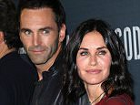 """LOS ANGELES, CA - AUGUST 19:  Musician Johnny McDaid (L) and actress Courteney Cox attend the premiere of Amazon's Series """"Hand of God"""" at Ace Theater Downtown LA on August 19, 2015 in Los Angeles, California.  (Photo by David Livingston/Getty Images)"""