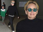 30 Nov 2015 Los Angeles - USA\n*** STRICTLY AVAILABLE FOR UK AND GERMANY USE ONLY ***\n*** EXCLUSIVE ALL ROUND PICTURES ***\nSharon Stone flashes a smile as she heads through LAX Airport with her sons Laird and Quinn. The 'Agent X' actress dressed comfortably for her flight as she wore a black turtleneck sweater over a striped shirt, matching black trousers and white shoes.\nBYLINE MUST READ : XPOSUREPHOTOS.COM\n***UK CLIENTS - PICTURES CONTAINING CHILDREN PLEASE PIXELATE FACE PRIOR TO PUBLICATION ***\n*UK CLIENTS MUST CALL PRIOR TO TV OR ONLINE USAGE PLEASE TELEPHONE 0208 344 2007*\n