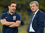 File photo dated 10-09-2013 of England manager Roy Hodgson (right) with coach Gary Neville. PRESS ASSOCIATION Photo. Issue date: Wednesday December 2, 2015. Gary Neville has been appointed head coach of Valencia until the end of the season, the Primera Division club have announced. See PA story SOCCER Valencia. Photo credit should read Owen Humphreys/PA Wire.